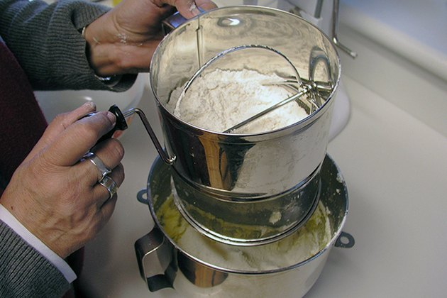Sifting dry ingredients into the mix