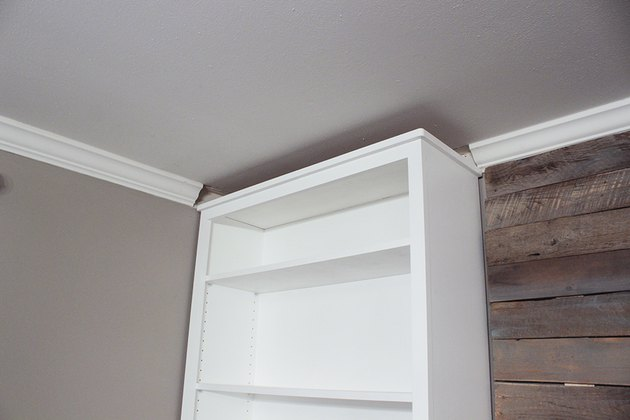 Bookcase with gap against ceiling.