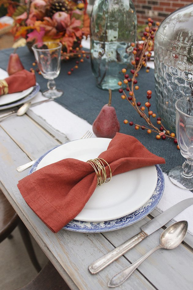 Gold wire napkin ring on a fall tablescape
