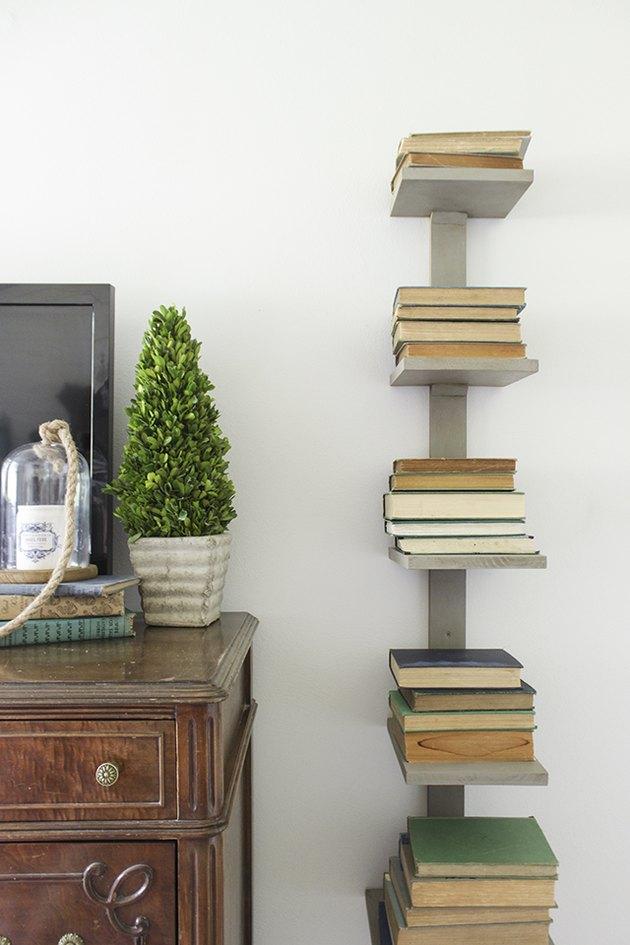vertical bookshelf alongside a dresser