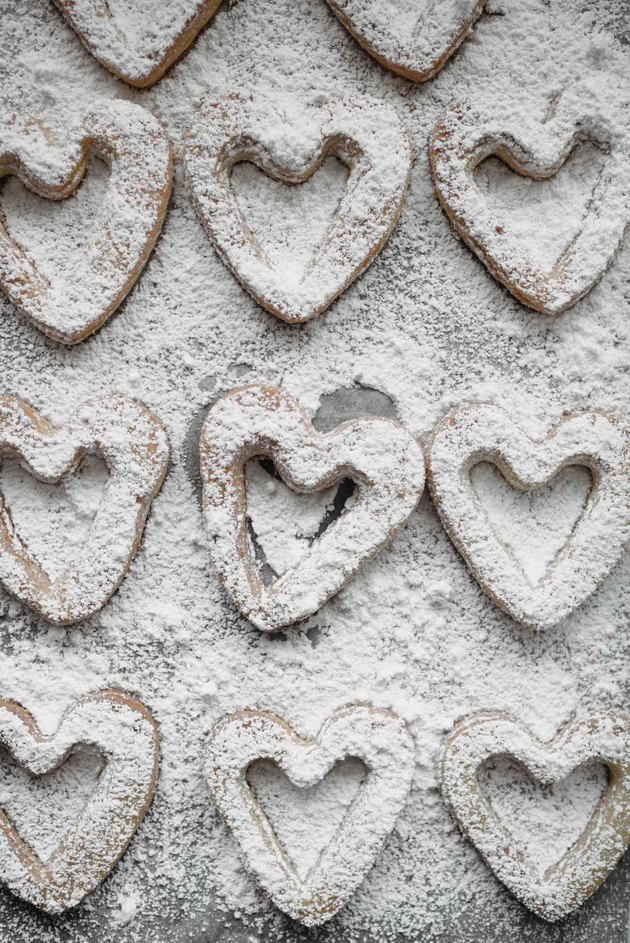 Sift the powdered sugar over the cut-out cookies.