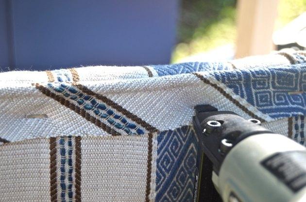 staple piping onto underside of upholstered bench