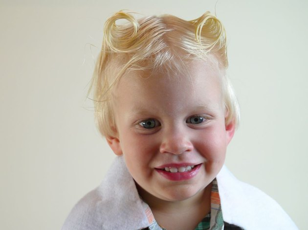 Little boy with his hair in two twists.