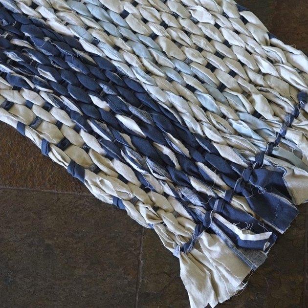 Woven rag rug using cardboard loom.