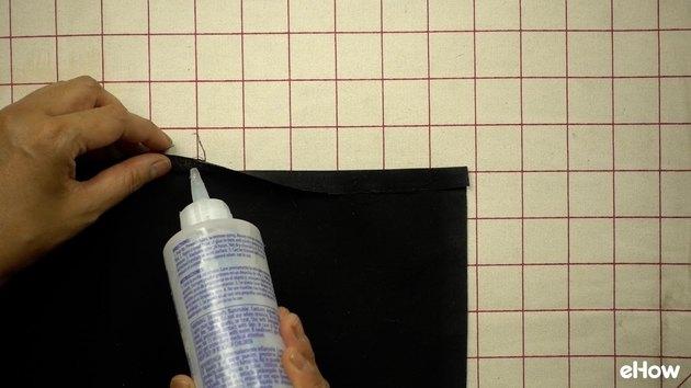 Hemming DIY mudcloth-inspired wall hanging.