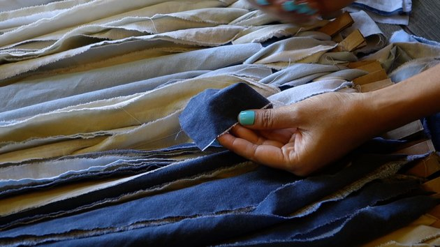 Joining two strips of fabric end to end for woven rag rug.