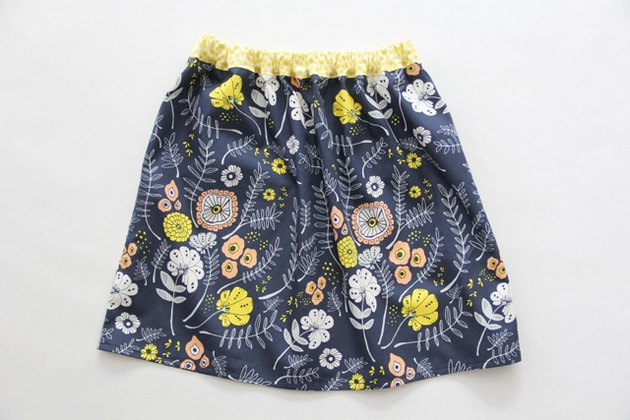 Sew an easy elastic waistband onto your gathered skirt