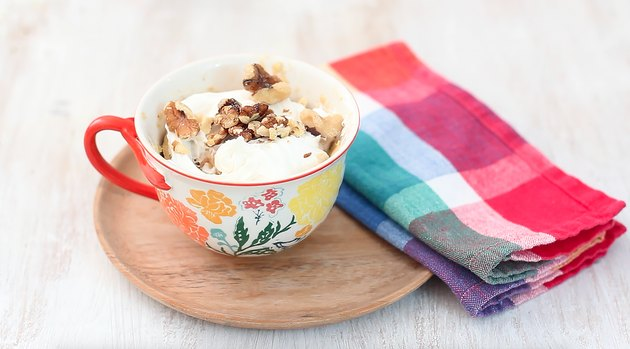 carrot mug cake garnished with walnuts