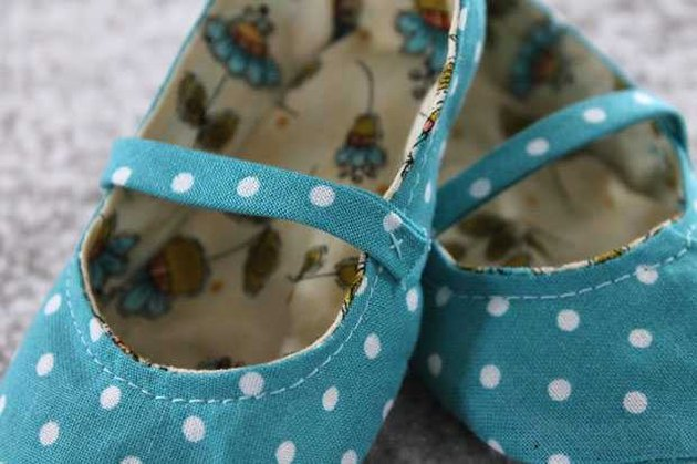 Finished aqua cloth baby shoes