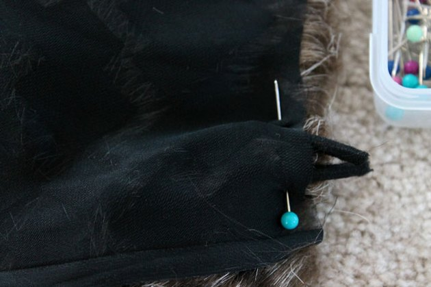 Pin the hair elastic between the lining and the faux fur.