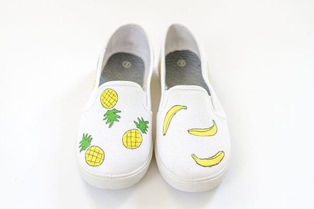 Canvas shoes with painted pineapples and bananas