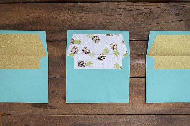 Three finished envelope liners.