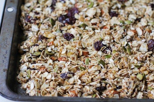 Raw granola ingredients on a baking sheet