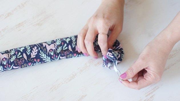 Threading elastic through fabric