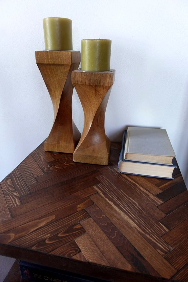 DIY herringbone pattern tabletop using paint sticks.