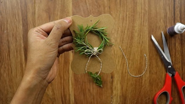 DIY rosemary Christmas wreath gift tag.