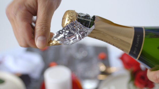 Remove foil from champagne bottle.