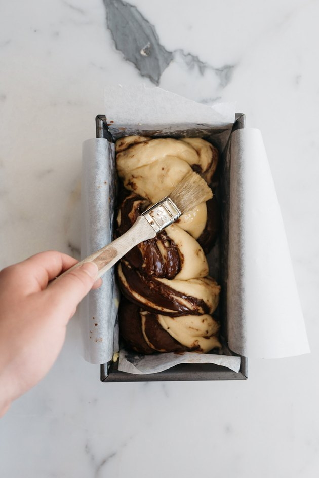 Coat the babka with a thin layer of egg wash.