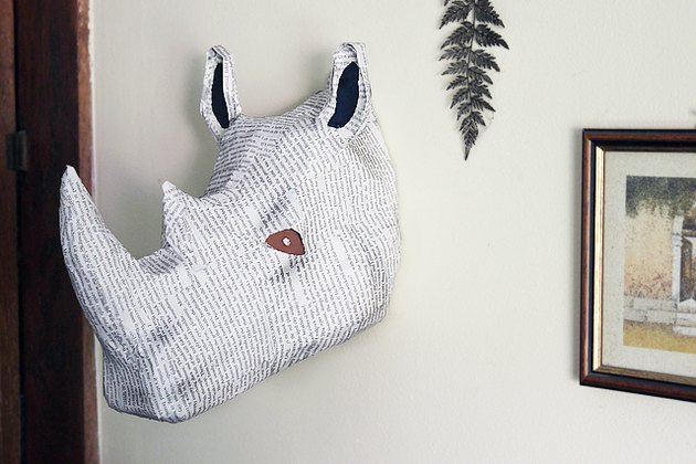 rhino bust hanging on wall