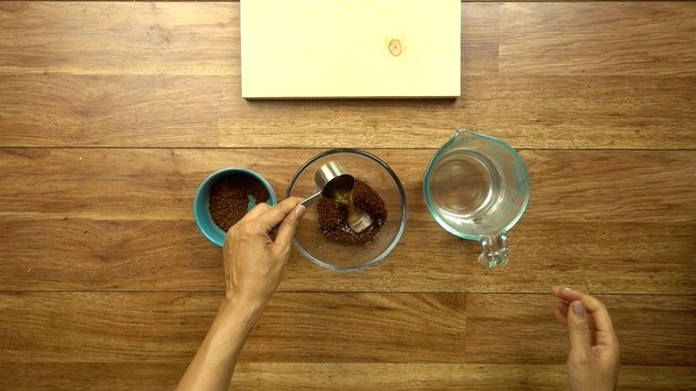 Mixing instant coffee and hot water for easy way to stain wood with coffee.