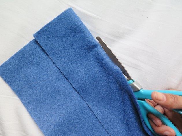 Cutting the felt along the fold.