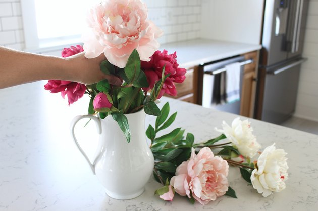Arrange flowers in vase