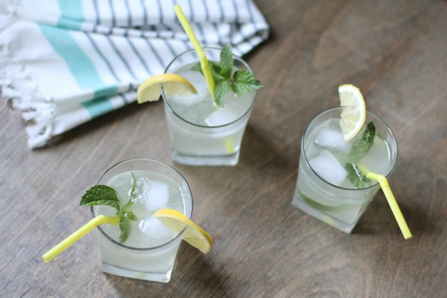 Three glasses of sparkling lemonade with mint garnish