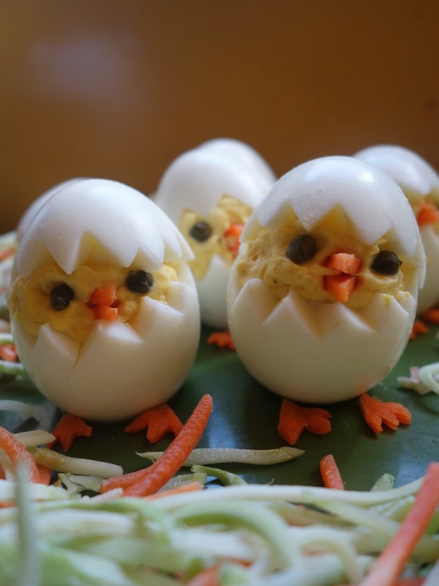 Deviled egg Easter chicks on plate.