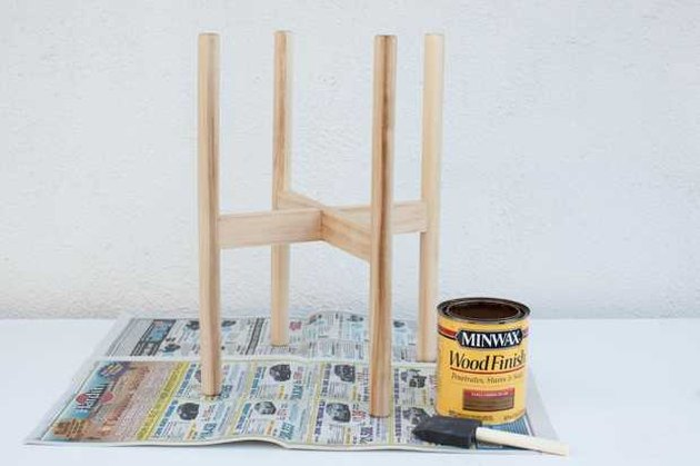 Applying stain to the plant stand