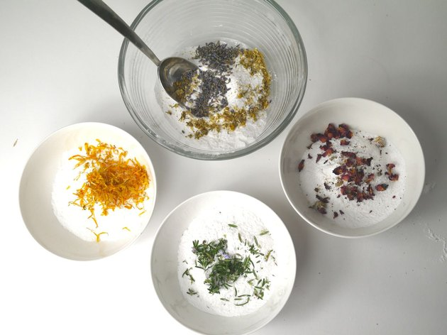Four mixing bowls with the different added ingredients.