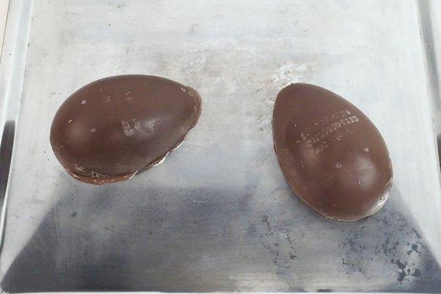 Heat two chocolate halves