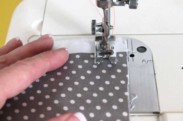 guide the fabric with hands as you sew