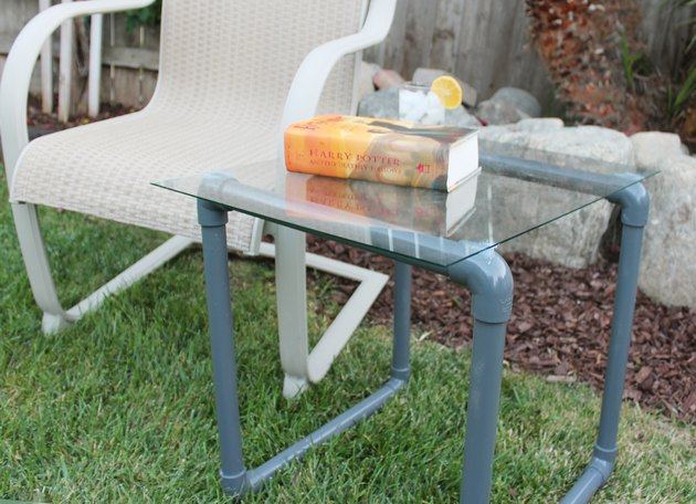 pvc pipe table outside next to lounge chair