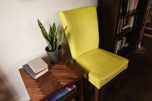Fabric chair painted with chalk paint in living room.