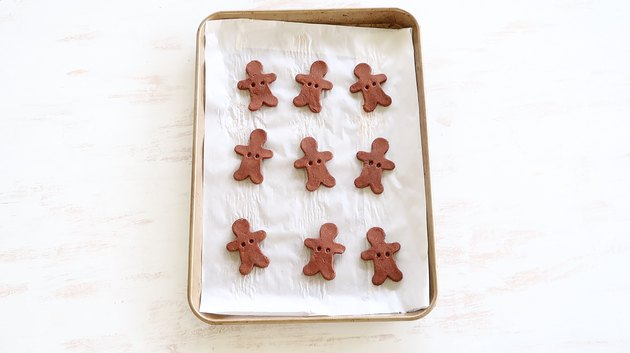 Gingerbread men cooling on baking sheet