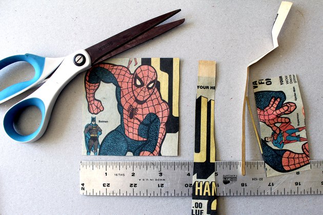 cut a square piece of comic book paper for slate coasters
