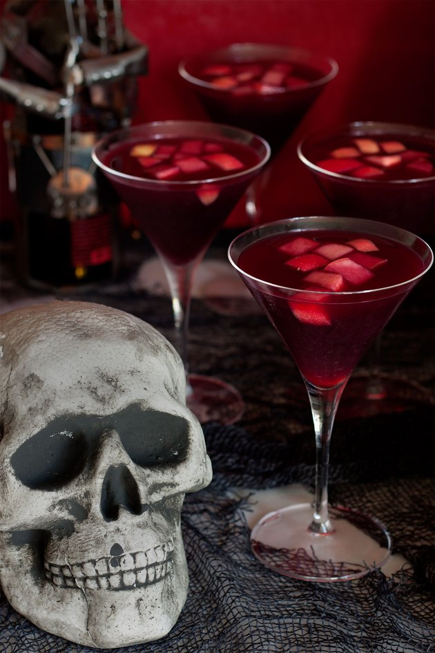 Close up of sangria glasses and skull