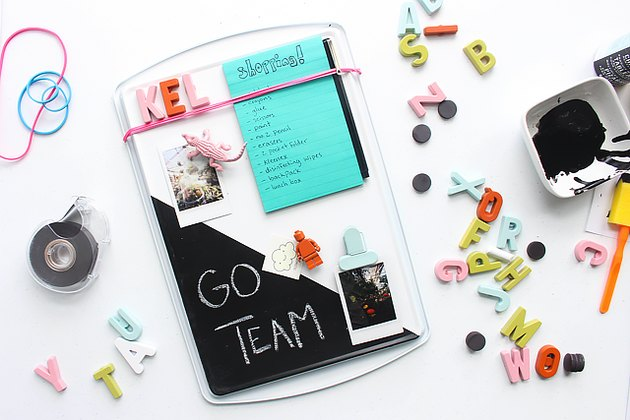 cookie sheet memo board decorated with magnets, photos and notepads