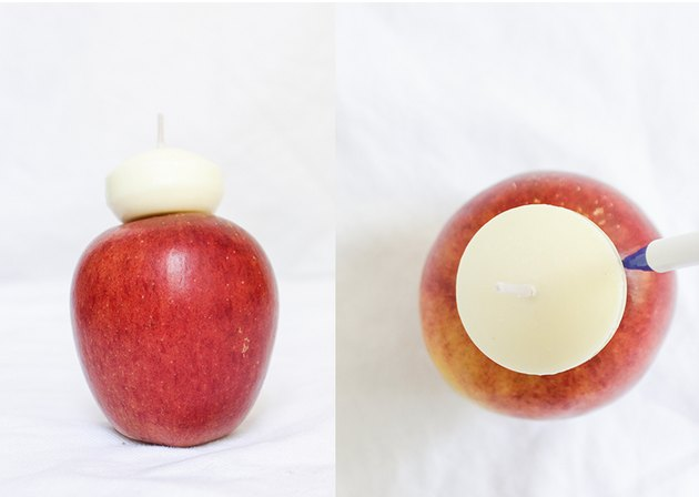 Floating candle on top of apple, being traced.