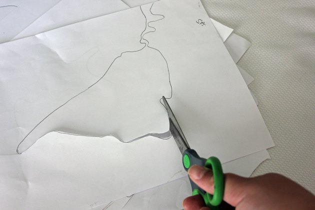 Cut out the continent templates with scissors.