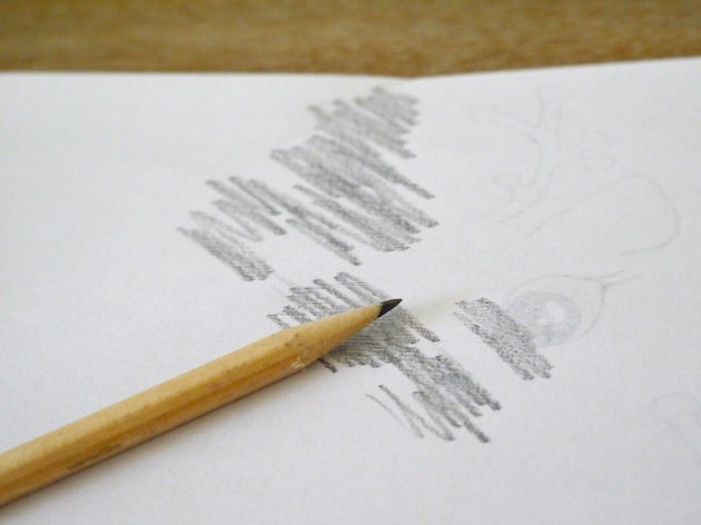 The back of the template covered in graphite pencil