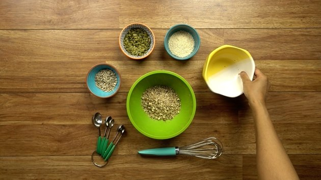 Mixing nuts and seeds for healthy seed and nut crispbread crackers.