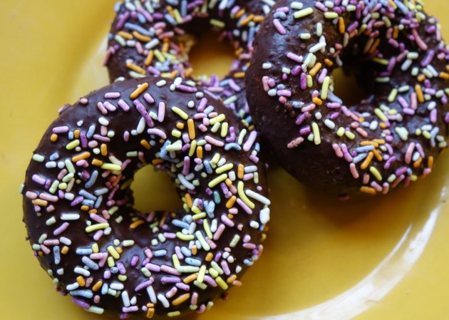 Healthy coconut flour low carb chocolate covered donuts with sprinkles.