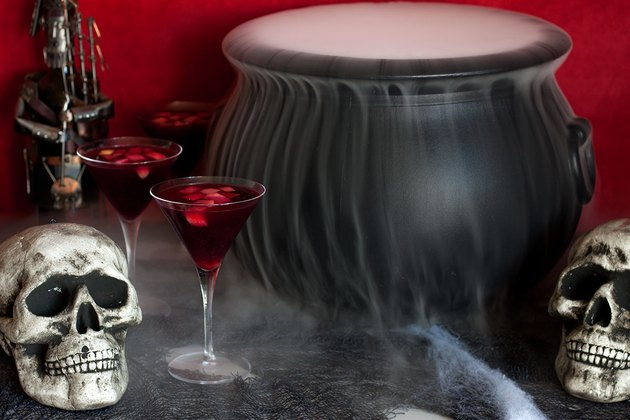 Smokey cauldron with sangria glasses and skulls