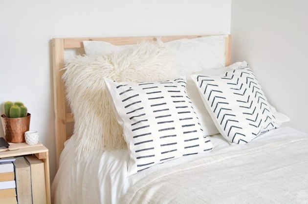 Mudcloth cushions on bed.