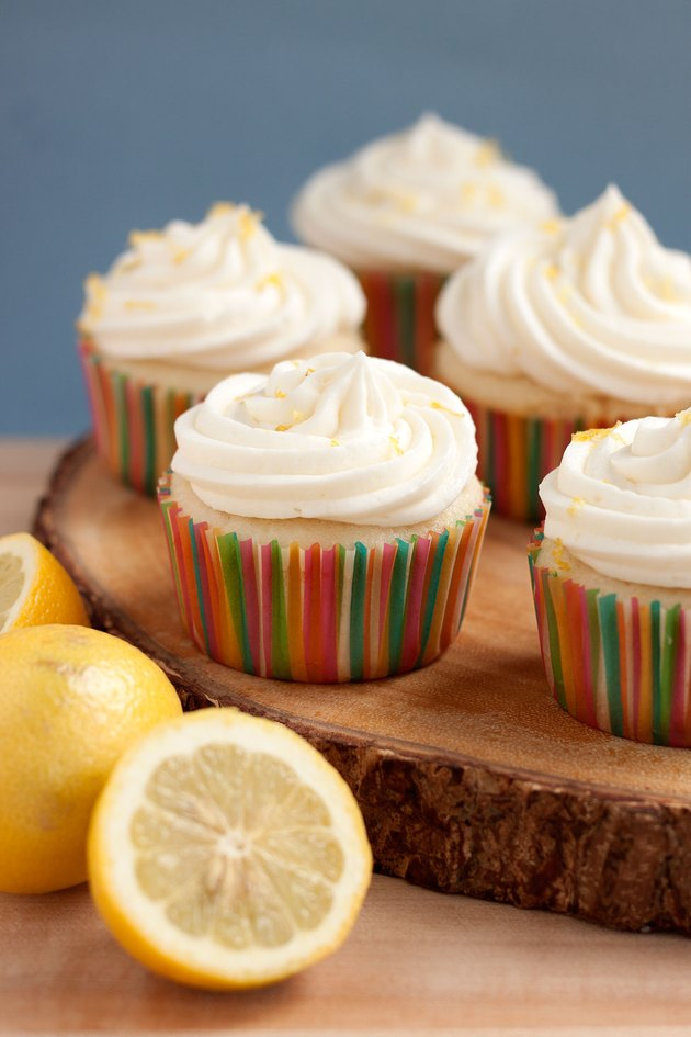 Close up of lemonade cupcake with sliced lemons.