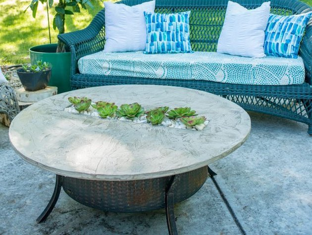 Faux cement finish fire pit cover with succulent insert