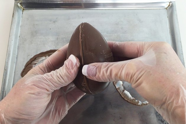 Pressing the chocolate halves together