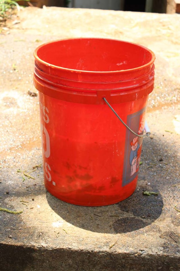 Pour hot water into the bucket.