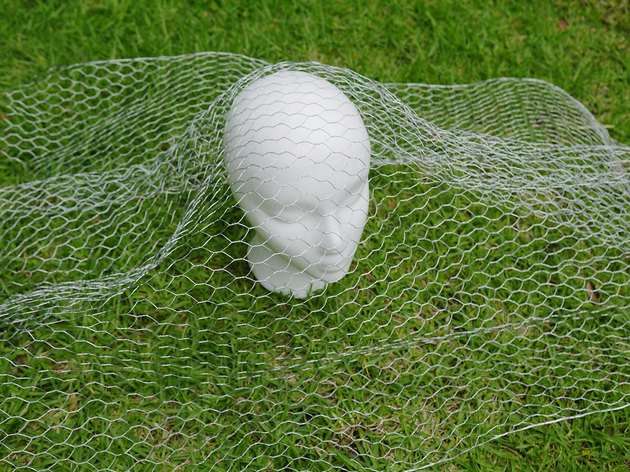 Chicken wire over the head.